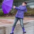 Wind blows the womans umbrella away — Stock Photo #71593931