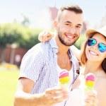 Joyful couple eating ice-cream cones — Stock Photo