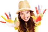 Joyful girl with paint on her hands — Stock Photo