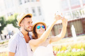 Happy couple taking selfie in the park — 图库照片