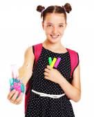 Happy schoolgirl with set of school stationary — Stock Photo