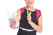 Midsection of a schoolgirl with set of stationary — Stock Photo