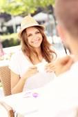 Joyful woman on a date in cafe — Stock Photo