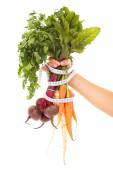 Vegetables tape measure and hand — Stock Photo