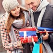 Happy couple with Christmas presents — Stock Photo #56604721