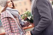 Romantic couple on a date with flowers — Stock Photo