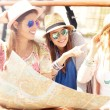 Group of tourists using map — Stock Photo #73630157