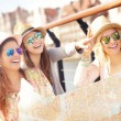 Group of tourists using map — Stock Photo #73630185