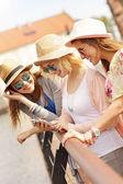 Three friends using smartphone — Stock Photo