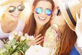 Female friends making a birthday surprise — Stock Photo