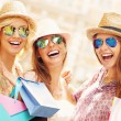 Group of happy friends shopping — Stock Photo #74007683