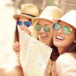 Group of tourists using map — Stock Photo #74007727