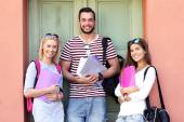 Group of happy students studying — Stock Photo
