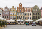 The facades of the old houses on the market square — Stock Photo
