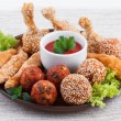 Various fried chicken appetizers with tomato dip — Stock Photo #65112699