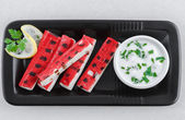Grilled surimi sticks a form of kamaboko, a processed seafood made of white fish flesh with garlic dip — Stock Photo