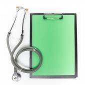 Medical clipboard and stethoscope isolated on white background. Concept of Healthcare And Medicine — Stock Photo