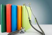 Medical stethoscope and stack of books. Medical professional education and information concept. — Stock Photo
