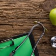 Alternative medicine - stethoscope, clipboard and green apple on wood table top view . Medical background. Concept for diet, healthcare, nutrition or medical insurance — Stock Photo #74095669