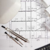Architectural blueprints, blueprint rolls, compass divider, calc — Stock Photo