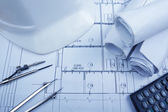 Architectural blueprints, blueprint rolls, compass divider, calc — Stock Photo