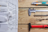 Architectural project, blueprints, blueprint rolls and divider compass, calipers on vintage wooden background. Construction concept. Engineering tools. Copy space — Foto Stock