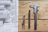 Architectural project, blueprints, blueprint rolls and divider compass, calipers on vintage wooden background. Construction concept. Engineering tools. Copy space — Stock fotografie