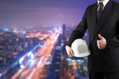 Close up of engineer hand holding white safety helmet for worker — Stock Photo