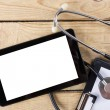 Workplace of a doctor. Tablet, stethoscope, black pen on wooden desk background. Top view — Stock Photo #74211627