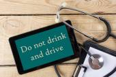 Do not drink and drive - Workplace of a doctor. Tablet, stethoscope, clipboard on wooden desk background. Top view — Foto de Stock