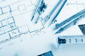 Architectural project, blueprints, blueprint rolls and divider compass, calipers, folding ruler on plans Engineering tools view from the top. Copy space. Construction background. Blue toned — Stock Photo