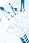 Architectural project, blueprints, blueprint rolls and divider compass, calipers, folding ruler on plans Engineering tools view from the top. Copy space. Construction background. Blue toned — Stockfoto