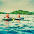 Two young men in a canoe — Stock Photo #52132085