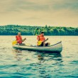 Men sailing a canoe — Stock Photo #52132091