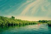 Two men canoeing down the river — ストック写真