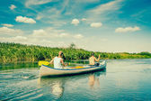 Two handsome guys in a canoe — Stock Photo