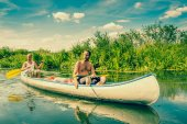 Exhausted men sailing in a canoe — Stock Photo