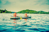 Two young men in a canoe — Stock Photo