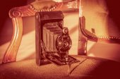 Antique folding camera — Stock Photo