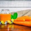 Carrot juice on a table with measure tape — Stock Photo #76584095
