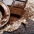 Silver sieve with cocoa dust on chocolate — Stock Photo #62961705