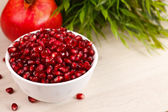 Grenadine seeds with fruit and leaves — Stock Photo