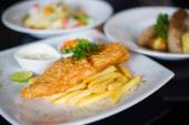 Fish and chips served with tartar sauce — Stock Photo