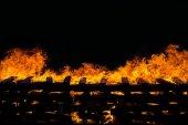 Fire burning wood pile — Stock Photo