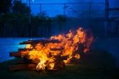 Camp fire burning wood — Stock Photo