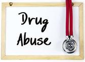 Drug abuse text write on blackboard — Stock Photo