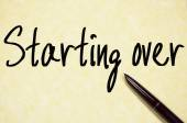 Starting over text write on paper — Stock Photo