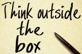Think outside the box text write on paper  — Stock Photo