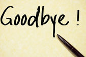 Goodbye word write on paper  — Stock Photo
