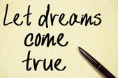 Let dreams come true text write on paper — Stock Photo
